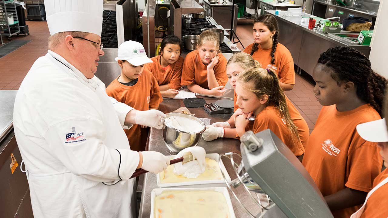 Campers watching chef demonstrate techniques
